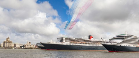 PICTURE PROVIDED FREE FOR EDITORIAL USE The Red Arrows in formation as CunardÕs fleet gather together in spectacular fashion in Liverpool, its spiritual home, as the company marked its 175th anniversary. Left to right: Queen Elizabeth, Queen Mary 2, Queen Victoria. The historic lines' three ships, the largest passenger ships ever to muster together on the River Mersey, lined up just 130 metres apart. The vessels lined up three abreast at Liverpool's Pier Head beside its iconic Three Graces: The Royal Liver Building, The Cunard Building and The Port of Liverpool Building. Picture date Monday 25th May, 2015. Picture by Christopher Ison. Contact +447544 044177 chris@christopherison.com